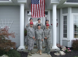 The Clemens family, with more than 120 years of collective military service, stands in front of the family home in Port Clinton, Ohio, after three of them returned from overseas deployments, March 17, 2005. Photo courtesy of the Clemens family