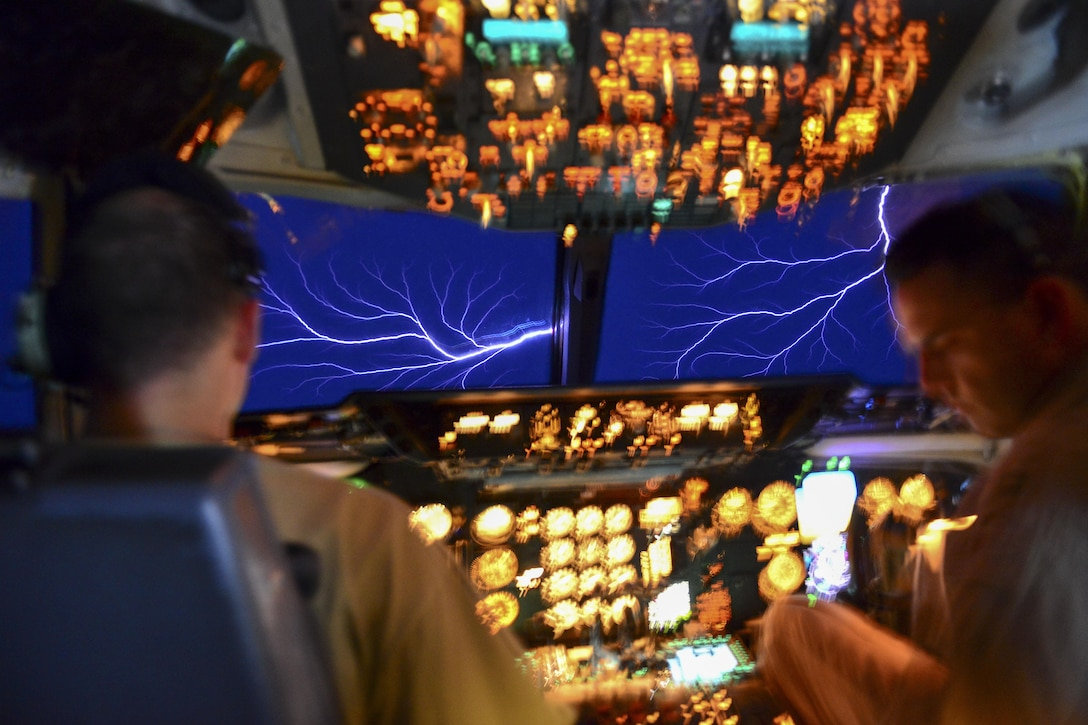 Air Force KC-10 pilots experience a weather phenomenon called St. Elmo Fire while flying through a thundercloud in an undisclosed location, March 22, 2017. The phenomenon occurs when the electric field around the aircraft causes ionization of the air molecules, producing a glow and sparks easily visible in low-light conditions. Air Force photo by Senior Airman Brian Kelly