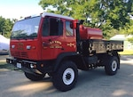 A former tactical logistics vehicle stands ready to help Acton firefighters fight brush fires.