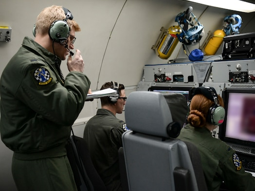 A member with more experience oversees two others during training, March 15, 2017, while flying over the Pacific Northwest. The AWACS worked with F-15s and other aircraft for realistic training scenarios during their time at Mountain Home Air Force Base, Idaho. (U.S. Air force photo by Senior Airman Jessica H. Smith)