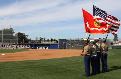 Marine Corps Recruiters of Substation Lakewood present colors during a varsity baseball game at St. John Bosco High School, Bellflower, Calif., March 14, 2017.