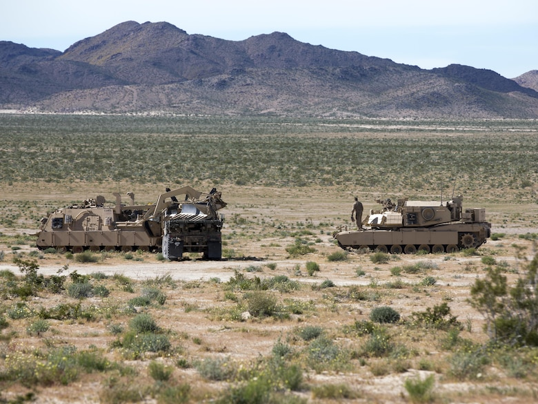 Logistic Vehicle System Replacement, an Assault Breacher Vehicle and an M88 Recovery Vehicle with 1st Tank Battalion prepare for departure during Exercise Desert March at Fort Irwin, Calif., March 26, 2017. He exercise was made to test the battalion's capabilities in handling a long distance movement as well as test the battalion's capabilities of logistically supporting the battalion throughout the exercise. (U.S. Marine Corps photo by Cpl. Thomas Mudd)