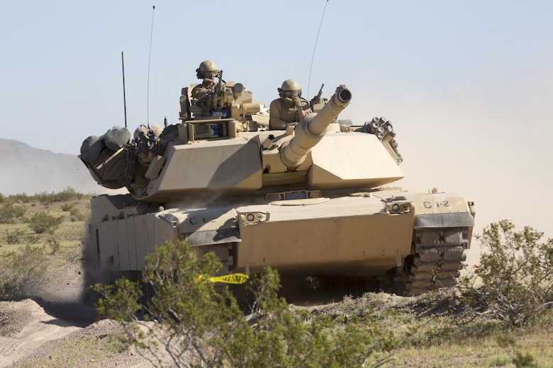 An M1A1 Abrams Main Battle Tank travels from Ft. Irwin, Calif., to Marine Corps Air Ground Combat Center, Twentynine Palms, Calif., during Exercises Desert March, March 27, 2017 He exercise was made to test the battalion's capabilities in handling a long distance movement as well as test the battalion's capabilities of logistically supporting the battalion throughout the exercise.  (U.S. Marine Corps photo by Cpl. Thomas Mudd)