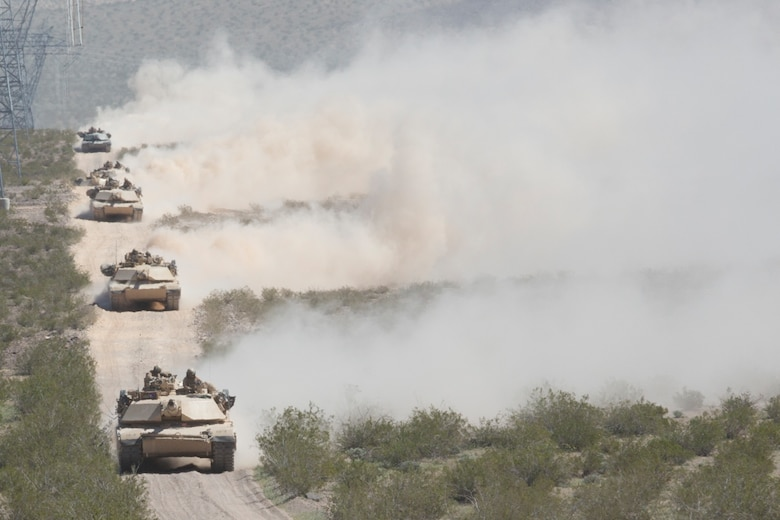 M1A1 Abrams Main Battle Tanks with 1st Tank Battalion cross into Marine Corps Air Ground Combat Center, Twentynine Palms, Calif., during Exercise Desert March, March 27, 2017. He exercise was made to test the battalion's capabilities in handling a long distance movement as well as test the battalion's capabilities of logistically supporting the battalion throughout the exercise.  (U.S. Marine Corps photo by Cpl. Thomas Mudd)