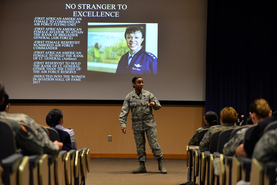 U.S. Air Force Senior Master Sgt. Gloria Weatherspoon, superintendent of the 55th Wing Equal Opportunity Office, talks about U.S. Air Force Lt. General Stayce Harris, Assistant Vice Chief of Staff and Director, Air Staff, Headquarters U.S. Air Force, Washington, D.C., in her presentation for Women's History Month ceremony hosted by the Offutt Diversity Team at the 557th Weather Wing's Chief Master Sgt. Peter Morris Auditorium, March 24, 2017, Offutt Air Force Base, Neb. Each of the four speakers was tasked with highlighting a women that has personally inspired them in their lives and or careers.