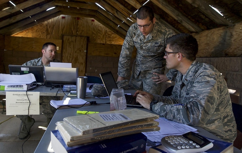 Contracting personnel from multiple bases discuss options for contracts after meeting with simulated vendors during a training exercise on Nellis Air Force Base, Nev., March 16, 2017. The training exercise included one day in the classroom, and one full day in the field, performing hands-on scenarios tailored to develop the skills and techniques necessary for setting up in remote, undeveloped locations. (U.S. Air Force photo by Airman 1st Class Kevin Tanenbaum/Released)