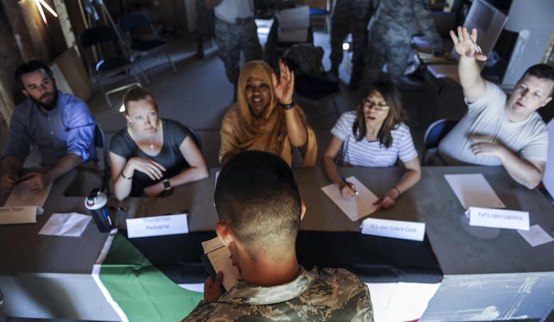 A contracting officer writes down what each of the simulated vendors can provide during a 99th Contracting Squadron training exercise on Nellis Air Force Base, Nev., March 16, 2017. Contracting Squadrons execute central acquisition and contract performance management programs on bases and in deployed environments. (U.S. Air Force photo by Airman 1st Class Kevin Tanenbaum/Released)