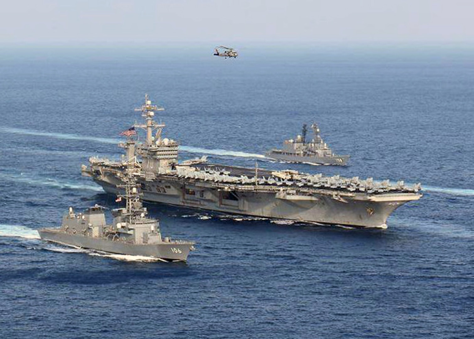 USS Carl Vinson (CVN 70) and Japan Maritime Self-Defense Force (JMSDF) ships steam in formation at the conclusion of a bilateral exercise to increase proficiency in basic maritime skills and improve response capabilities, Mar. 29, 2017. Over a three-day period the Carl Vinson Carrier Strike Group and JMSDF ships conducted multiple maneuvers testing their communications interoperability and ship handling techniques. The Carl Vinson Carrier Strike Group is on a regularly scheduled Western Pacific deployment as part of the U.S. Pacific Fleet-led initiative to extend the command and control functions of U.S. 3rd Fleet. U.S Navy aircraft carrier strike groups have patrolled the Indo-Asia-Pacific regularly and routinely for more than 70 years.