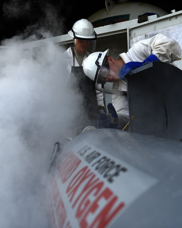U.S. Air Force Senior Airman Jesse Frady and U.S. Air Force Senior Airman Richard Hayes, 19th Logistics Readiness Squadron fuel cryogenics journeymen, fill a 50-gallon container with liquid oxygen, or LOX, March, 27, 2017, at Little Rock Air Force Base, Ark. Frady and Hayes supply C-130J pilots with fresh oxygen so they can perform high altitude air drops, air medical evacuations and with stand high altitude cabin decompressions. (U.S. Air Force photo by Airman 1st Class Kevin Sommer Giron)