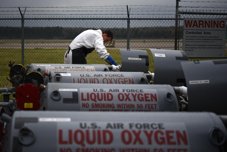 U.S. Air Force Senior Airman Richard Hayes, 19th Logistics Readiness Squadron fuel cryogenics journeyman, opens a vent valve to release excess pressure within liquid oxygen carts March 27, 2017, at Little Rock Air Force Base, Ark. Cryogenic Airmen fill and maintain containers with liquid oxygen to provide fresh air to pilots in flight. (U.S. Air Force photo by Airman 1st Class Kevin Sommer Giron)