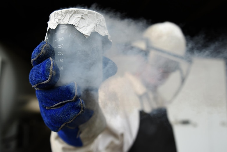 U.S. Air Force Senior Airman Jesse Frady, 19th Logistics Readiness Squadron fuel cryogenics journeyman, takes a sample of liquid oxygen, or LOX, for odor testing March, 28, 2017, at Little Rock Air Force Base, Ark. Before the oxygen makes its way to pilots, Frady uses an odor sample beaker with filter paper to test for contamination. (U.S. Air Force photo by Airman 1st Class Kevin Sommer Giron)