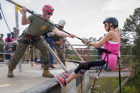 Pamela Lacombe, a counselor at Delhi Charter High School in Delhi, Louisiana, descends from the rappel tower Mar. 30, 2017, during the Recruiting Stations Baton Rouge and Jacksonville Educators Workshop aboard Marine Corps Recruit Depot Parris Island, South Carolina. The Educators come from both Recruiting Station Baton Rouge and Jacksonville to experience the Educators Workshop. The workshop allows educators to have an inside look at educational benefits and career opportunities in the Marine Corps to better inform their students.(Official Marine Corps photo by Cpl. Adeline N. Smith/Released)