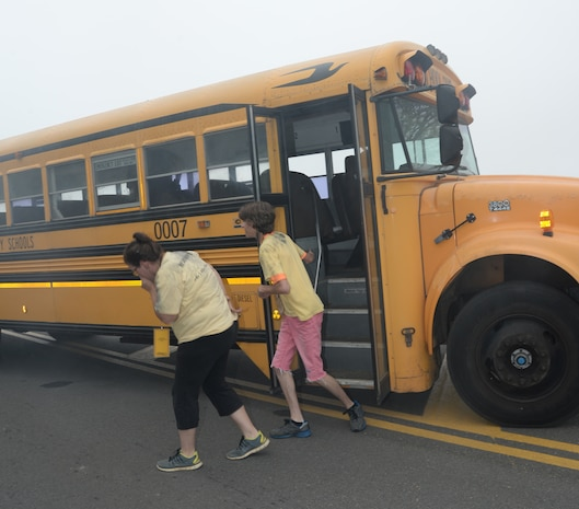 Role players disembark a school bus during a simulated hazardous material release while participating in Exercise Vigilant Guard aboard Marine Corps Logistics Base Albany, March 29.