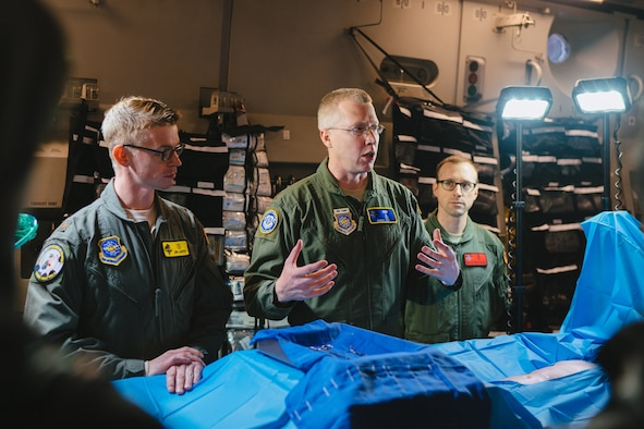 Maj. Denial Cox, Office of the Command Surgeon medical director for en route care, briefs congressional staff members on flight surgical capabilities during the 2017 Rapid Global Mobility Airpower Orientation at Joint Base Andrews, Md., March 31, 2017. (U.S. Air Force photo by Senior Airman Delano Scott)