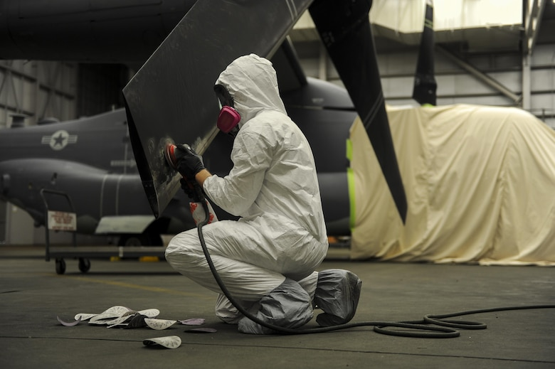 Airman 1st Class Ethan Short, an aircraft structural maintainer with the 1st Special Operations Maintenance Squadron, sands down a propeller to remove paint from a CV-22 Osprey at Hurlburt Field, Fla., March 28, 2017. Sanding down the equipment is the first step in a several day process to ensure the new primer and paint adhere to the surface of the aircraft. (U.S. Air Force photo by Airman 1st Class Isaac O. Guest IV)