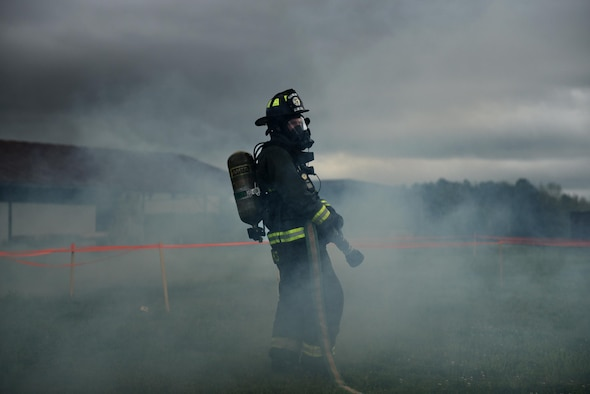 U.S. Air Force Senior Airman Lance Hendricks, 19th Civil Engineer Squadron Fire Department firefighter, responds to a simulated aircraft crash site during a major accident response inspection March 30, 2017, at the Jacksonville Fire Department Training Center, Ark. The goal of the exercise was to evaluate Team Little Rock's response to an aircraft mishap. (U.S. Air Force photo by Airman 1st Class Kevin Sommer Giron)