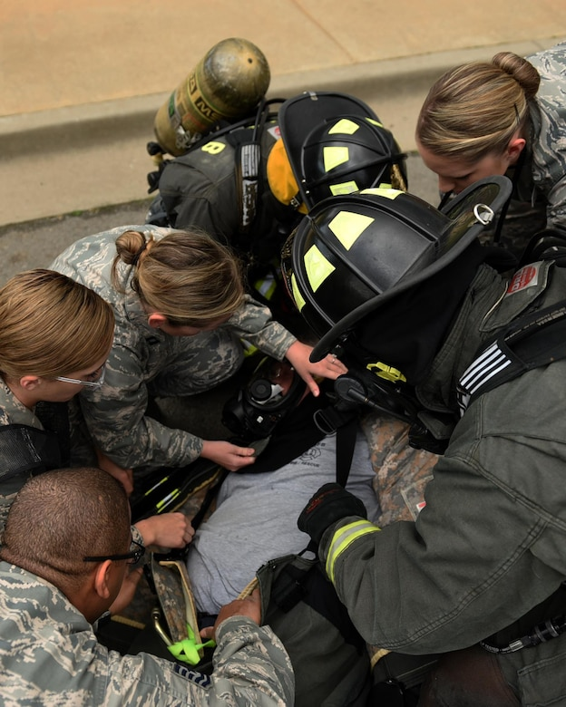 Members of the 19th Aerospace Medicine Squadron check vitals on U.S. Air Force Michael Leger, 19th Civil Engineer Squadron Fire Department firefighter, during a major accident response inspection March 30, 2017, at the Jacksonville Fire Department Training Center, Ark. The 19th AMDS response team was responsible for stabilizing patients, checking their vitals, and coordinating transfers to the emergency room. (U.S. Air Force photo by Airman 1st Class Kevin Sommer Giron)