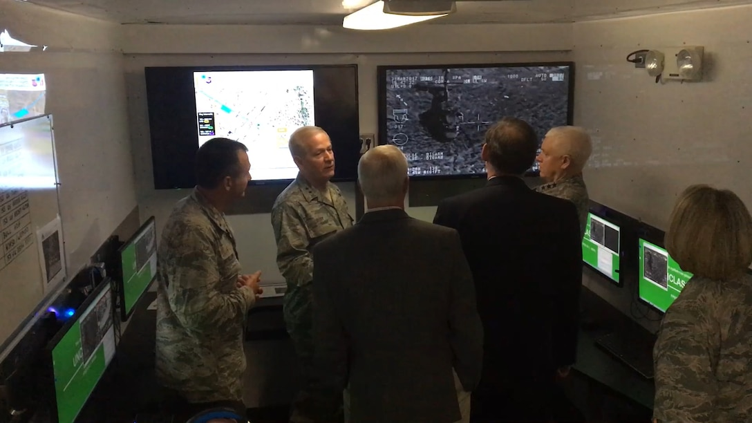 Lt. Gen. L. Scott Rice, director of the Air National Guard, is shown the 188th Wing's remote air, zonal operations, reach back-processing, assessment and dissemination (RAZORBack PAD) March 31, 2017, while visiting Ebbing Air National Guard Base, Fort Smith, Ark. The RAZORBack PAD was used to show how 188th Airmen can monitor video footage from aircraft while in a mobile location. (U.S. Air National Guard photo by Tech. Sgt. Chauncey Reed)