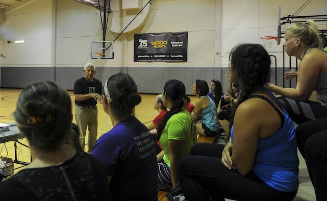 """Michael """"Moose"""" Moore, founder and CEO of The Vigilance Group, gives a presentation to a group of Air Commando spouses on awareness, avoidance and actions to take during assaults at Hurlburt Field, March 31, 2017. The Stroller Warriors Running Club hosted The Vigilance Group to offer individuals the opportunity to learn preventive security training. Techniques such as hammer fists, palm strikes, chock defenses and bear hug escapes were demonstrated. (U.S. Air Force photo by Airman 1st Class Isaac O. Guest IV)"""