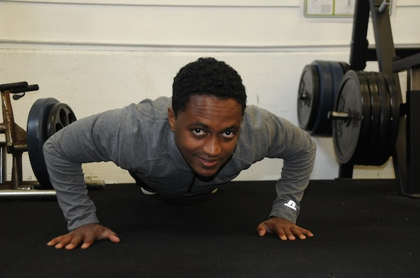 Trainee Mathias Sendekie performs a push-up during a drill weekend at the 129th Rescue Wing, April 3, 2016. (U.S. Air National Guard photo by Senior Airman Brian Jarvis/Released)