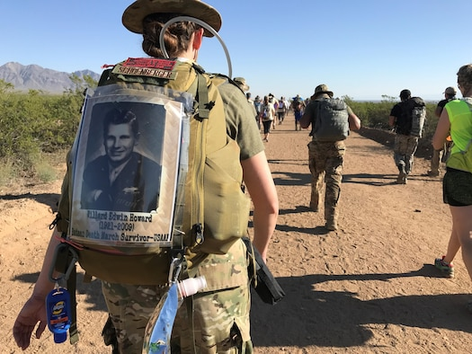 For Air Force 2nd Lt. Amber Schoenberger marches in the Bataan Memorial Death March Marathon March 19 at White Sands Missile Range, NM, in honor of her grandfather (pictured on her backpack), U.S. Army Air Forces Cpl Willard Edwin Howard (1921-2009), who survived the grueling march in 1942. (Courtesy photo)