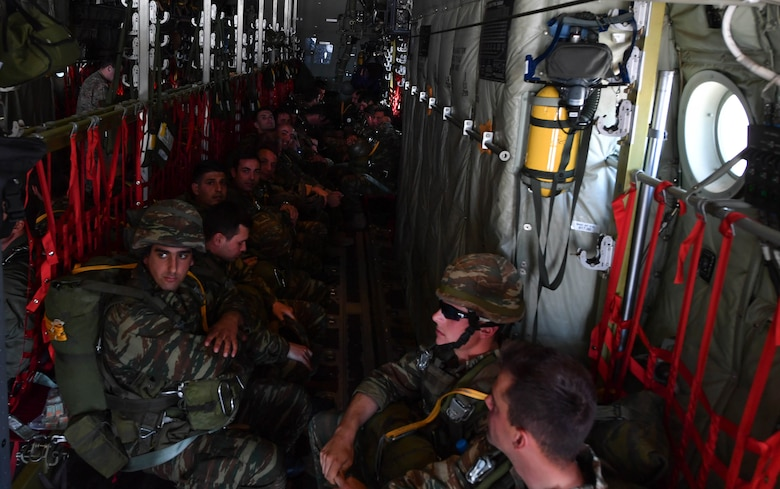 Greek paratroopers sit inside a U.S. Air Force C-130J Super Hercules during Exercise Stolen