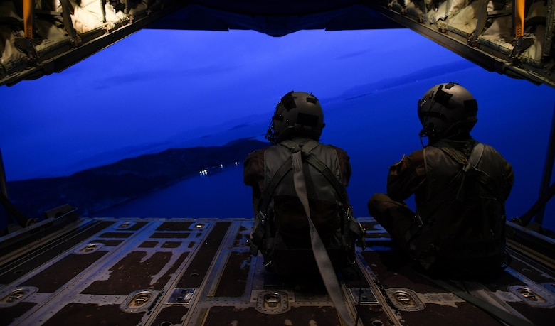U.S. Air Force Senior Airman Matthew Gee, left, and Master Sgt. CJ Campbell, both 37th Airlift Squadron aircraft loadmasters, sit on the open ramp of a C-130J Super Hercules during Exercise Stolen Cerberus IV near Elefsis Air Base, Greece, April 19, 2017. The 37th AS loadmasters have worked with the Hellenic air force to prepare C-130s for personnel, heavy equipment, platforms, container delivering system bundles, and low-cost low-altitude bundles throughout the exercise. As NATO allies, the U.S. and Greece share a commitment to promote peace and stability, and seek opportunities to continue developing their strong relationship. (U.S Air Force photo by Senior Airman Tryphena Mayhugh)