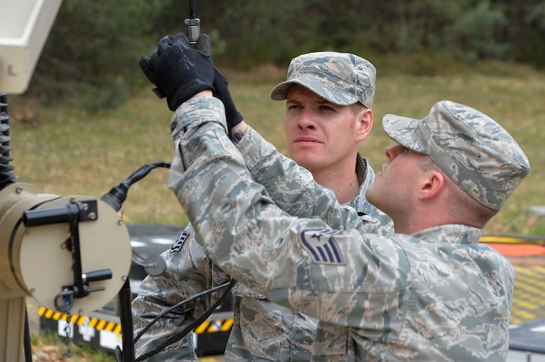 Staff Sgt. Joshua Miles, 1st Combat Communications Squadron radio frequency transmissions technician, and Staff Sgt. Jason Renfroe, 263rd CBCS client systems technician, work on a communications antenna during an exercise on Ramstein Air Base, Germany, April 26, 2017. The exercise featured the first total force integrated combat communications team for U.S. Air Forces in Europe and Air Forces Africa. (U.S. Air Force photo by Airman 1st Class Joshua Magbanua)