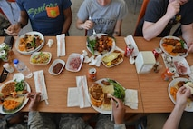 U.S. Airmen eat Turkish food together during a spiritual lunch and learn, April 27, 2017, at Diyarbakir Air Base, Turkey. During the luncheon, Airmen learned about each other's values. (U.S. Air Force photo by Senior Airman John Nieves Camacho)