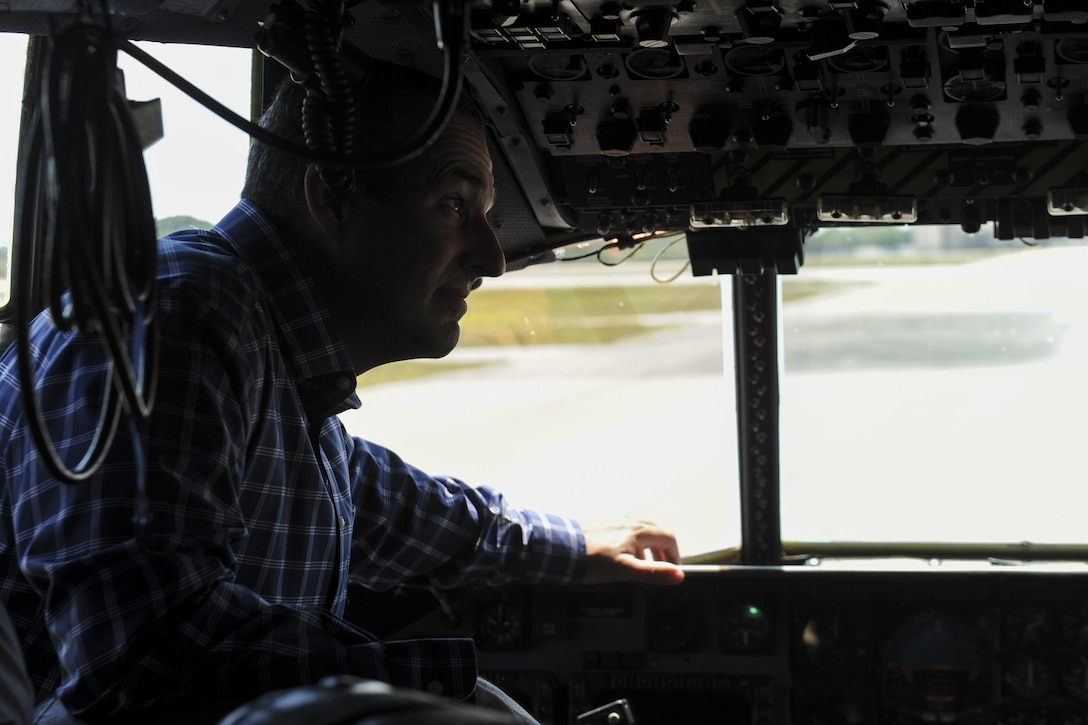 Troy Hamilton, the senior pastor at Rocky Bayou Baptist Church in Niceville, Fla., examines the cockpit of an MC-130 Combat Talon II during a Clergy Day event at Hurlburt Field, Fla., April 26, 2017. Local clergyman participated in a static tour of Hurlburt's MC-130. The tour participants were briefed on the aircraft's capabilities, its mission and other various aspects of the aircraft. (U.S. Air Force photo by Airman 1st Class Dennis Spain)