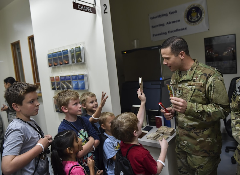 1st Lt. Eric Dixon, a chaplain with the 1st Special Operations Wing, briefs children on chapel services available to deployed service members during Operation Kids Understanding Deployment Operations at Hurlburt Field, Fla., April 22, 2017. Children processed through a deployment line where they received dog tags, shirts and deployment bags. (U.S. Air Force photo by Airman 1st Class Joseph Pick)