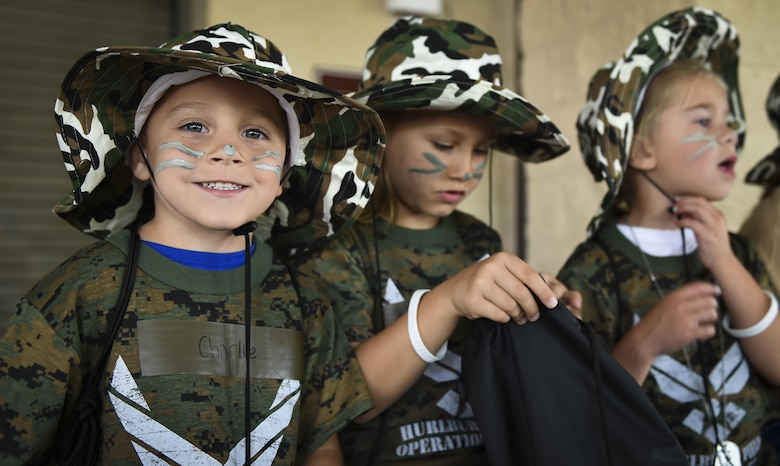 A military child poses for a photo during Operation Kids Understanding Deployment Operations at Hurlburt Field, Fla., April 22, 2017. Operation KUDOS is an educational event aimed to help build resilience in military youth by engaging them in activities that simulate the pre-deployment experience, such as pre-deployment lines and demonstrations. (U.S. Air Force photo by Airman 1st Class Joseph Pick)