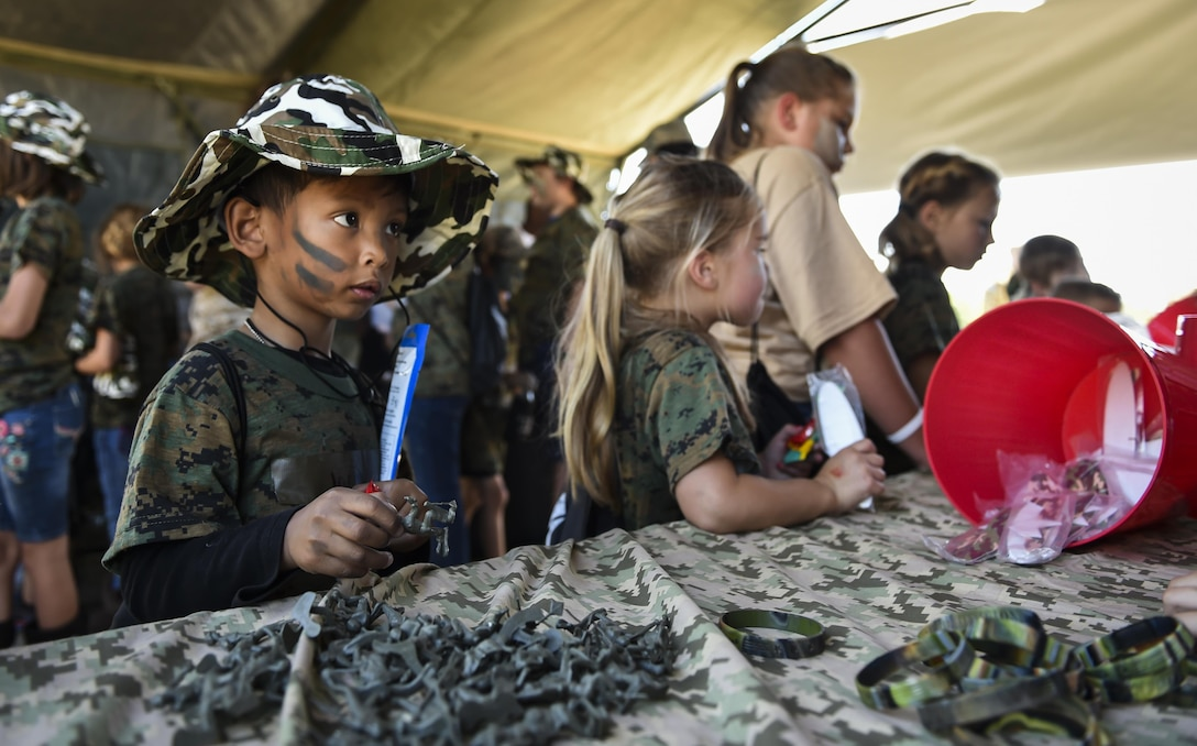 A military child shops at the field postal exchange during Operation Kids Understanding Deployment Operations at Hurlburt Field, Fla., April 22, 2017. Operation KUDOS is an educational event aimed to help build resilience in military youth by engaging them in activities that simulate the pre-deployment experience, such as pre-deployment lines and demonstrations. (U.S. Air Force photo by Airman 1st Class Joseph Pick)