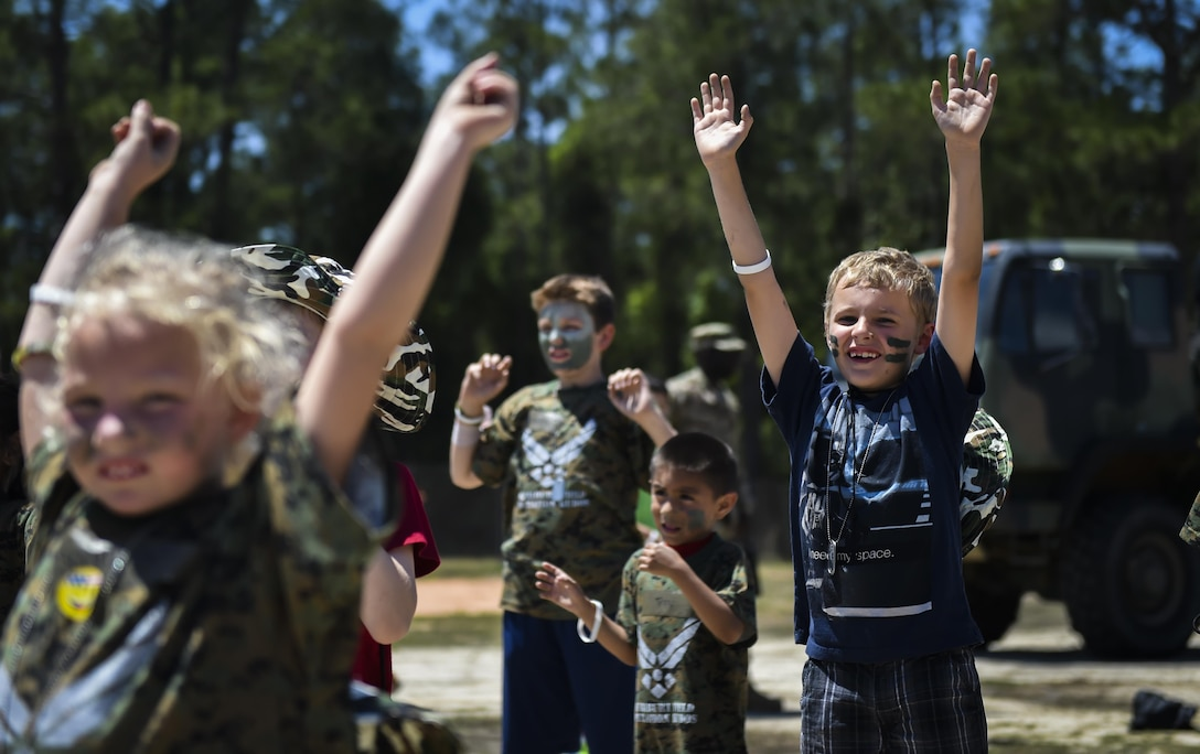 Military children participate in physical training at a deployed location during Operation Kids Understanding Deployment Operations at Hurlburt Field, Fla., April 22, 2017. At the deployed location, children visited a medical tent, shopped a field postal exchange and viewed a military working dog demonstration. (U.S. Air Force photo by Airman 1st Class Joseph Pick)