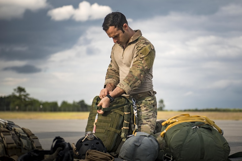 Senior Airman Matt, 38th Rescue Squadron pararescueman, readies a static-line parachute prior to a jump, April 24, 2017, at Moody Air Force Base, Ga. All PJs are qualified to conduct both static-line and High altitude, low opening jumps. During a static-line jump, the jumper is attached to the aircraft via the 'static-line', which automatically deploys the jumpers' parachute after they've exited the aircraft. (U.S. Air Force photo by Staff Sgt. Ryan Callaghan)