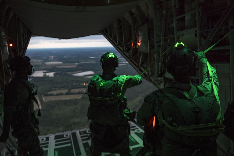 Pararescuemen from the 38th Rescue Squadron prepare to jump from an HC-130J Combat King II, April 24, 2017, at Moody Air Force Base, Ga. All PJs are qualified to conduct both static-line and High altitude, low opening jumps. During a static-line jump, the jumper is attached to the aircraft via the 'static-line', which automatically deploys the jumpers' parachute after they've exited the aircraft. (U.S. Air Force photo by Staff Sgt. Ryan Callaghan)