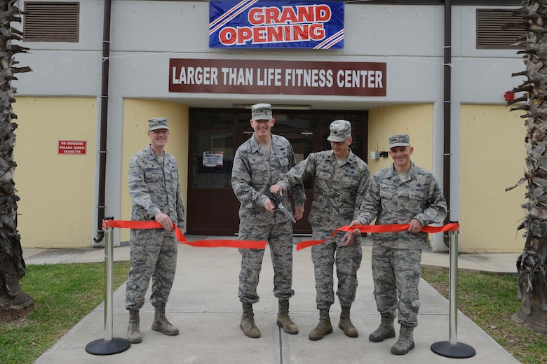 U.S. Air Force Col. Todd Straton, 39th Mission Support Group commander (Left), Col. John Walker, 39th Air Base Wing commander (second from left), Lt. Col. Kenneth Raszinski, 39th Force Support Squadron commander (second from right) and Command Chief Master Sgt. Thomas Cooper, cut the ribbon at the grand opening of the Larger Than Life Fitness Center May 1, 2017, at Incirlik Air Base, Turkey. The facilities were opened to reduce the amount of foot traffic in the base's main fitness and dining facilities. (U.S. Air Force photo by Airman 1st Class Devin M. Rumbaugh)