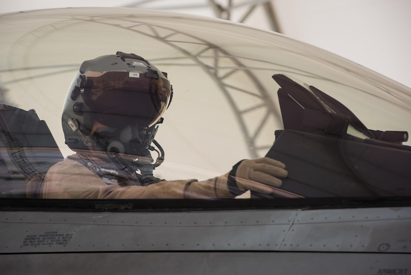 A Polish air force pilot performs preflight checks in an F-16 Fighting Falcon before taxiing for a mission at the 407th Air Expeditionary Group in Southwest Asia, April 24, 2017. The Polish airmen are part of the 60-nation coalition force supporting Operation Inherent Resolve in the fight against the Islamic State of Iraq and Syria. Air Force photo by Master Sgt. Benjamin Wilson