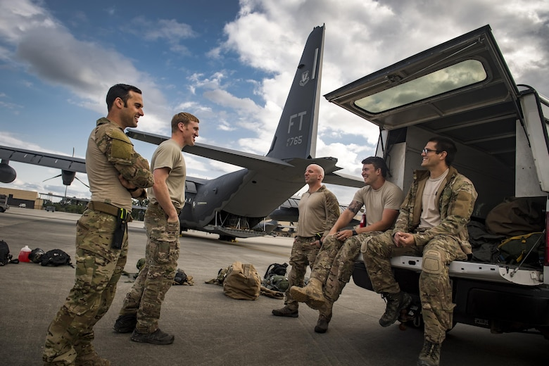 Senior Airman Matt, left, 38th Rescue Squadron pararescueman, laughs with fellow PJs prior to conducting static-line jumps, April 24, 2017, at Moody Air Force Base, Ga. All PJs are qualified to conduct both static-line and High altitude, low opening jumps. During a static-line jump, the jumper is attached to the aircraft via the 'static-line', which automatically deploys the jumpers' parachute after they've exited the aircraft. (U.S. Air Force photo by Staff Sgt. Ryan Callaghan)
