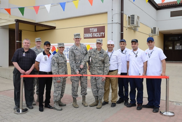 Members of the 39th Air Base Wing cut the ribbon at the grand opening of the Titan Dining Facility May 1, 2017, at Incirlik Air Base, Turkey. The grand opening marked the fourth dining facility on base. (U.S. Air Force photo by Airman 1st Class Devin M. Rumbaugh)