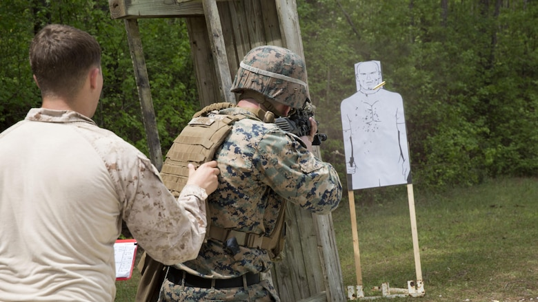 A Marine instructor directs a student to fire blank rounds at a stationary target during a sniper course at Marine Corps Base Camp Lejeune, N.C., April 19, 2017. The Expeditionary Operations Training Group ran the course to teach long-range precision marksmanship to Marines from different units. The students are with the 2nd Reconnaissance Battalion and the battalion landing team with the 26th Marine Expeditionary Unit.