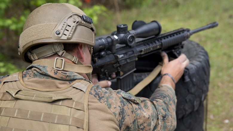 A Marine sights in on his target during an urban sniper course at Marine Corps Base Camp Lejeune, N.C., April 19, 2017. The Expeditionary Operations Training Group ran the course to teach long-range precision marksmanship to Marines from different units. The students are with the 2nd Reconnaissance Battalion and the battalion landing team with the 26th Marine Expeditionary Unit.