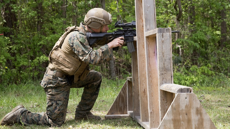 A Marine conceals himself as he sights in on his target during a sniper training course at Marine Corps Base Camp Lejeune, N.C., April 19, 2017. The Expeditionary Operations Training Group ran the course to teach long-range precision marksmanship to Marines from different units. The students are with the 2nd Reconnaissance Battalion and the battalion landing team with the 26th Marine Expeditionary Unit.