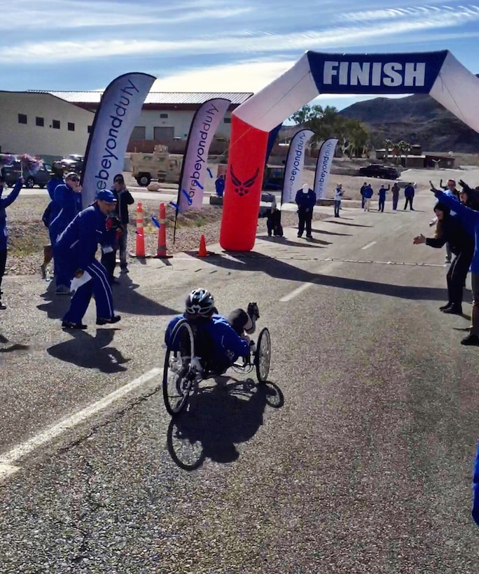 Lt. Col. Jackie Burns, 552nd Air control Group, 552nd Air Control Wing, prepares to cross the finish line on her way to earning a Silver Medal in Cycling on a recumbent bike , at the Wounded Warrior Trials held Feb. 17, at Nellis Air Force Base, Nev.  Burns was selected to the primary Air Force team which will compete at the Warrior Games June 30- July 8 in Chicago.  (Air Force photo by Marty Burns)