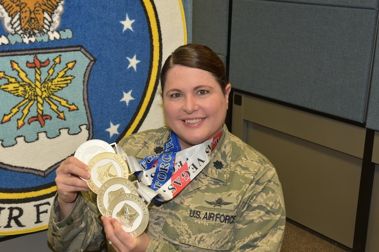 Lt. Col. Jackie Burns, 552nd Air control Group, 552nd Air Control Wing, displays the medals she earned at the Wounded Warrior Trials at Nellis Air force Base, Nev. Feb. 17. Burns had Silvers in 5K Cycling, 100-meter Free Style, Discus and a Bronze Medal in the 50-meter BackStroke.  Burns was selected as a primary Wounded Warrior team member and will compete in the Warrior Games June 30-July 8 in Chicago.  (Air Force photo by Ron Mullan)