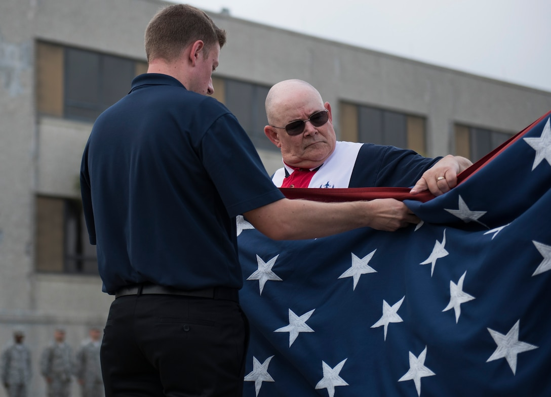 Team Eglin civilians fold the flag during the all-civilian retreat ceremony April 27 at Eglin Air Force Base, Fla. The all-civilian retreat was held to show support for our military members. (U.S. Air Force photo/Ilka Cole)
