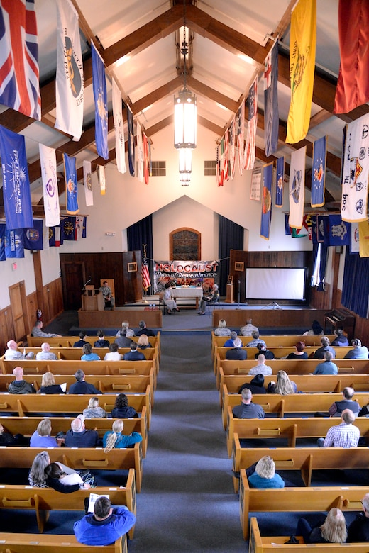 Attendees listen to guest speakers during the Holocaust Remembrance Day service at the Nate Mazar Chapel, April 25, 2017. Holocaust survivor Liesel Shineberg and Dr. Karen Hirsch were the event's guest speakers. The service was organized by the Team Hill Special Observance Council, Holocaust Remembrance Committee. (Todd Cromar/U.S. Air Force)