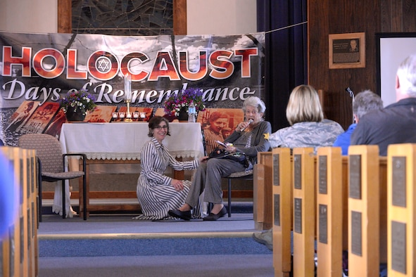 Holocaust survivor, Ms. Liesel Shineberg, right, and Dr. Karen Hirsch speak during a Holocaust Remembrance Day service at the Hill Aerospace Museum's Nate Mazer Chapel, April 25, 2017. The service was organized by the Team Hill Special Observance Council, Holocaust Remembrance Committee. (Todd Cromar/U.S. Air Force)
