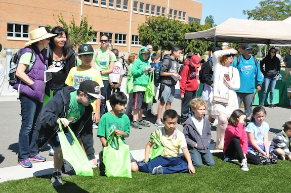 Students from local schools adamantly listen to a speech given during the 63d Regional Support Command Earth Day event held at the Sergeant James Witkowski Armed Forces Reserve Center in Mountain View.