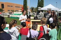 The 63d Regional Support Command Soldiers and students learn about the process of making honey and importance of bees from Kendal's Bees during the Earth Day event held at the Sergeant James Witkowski Armed Forces Reserve Center in Mountain View.